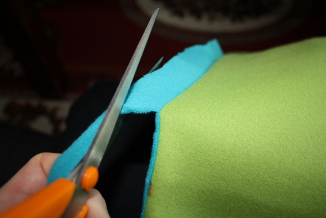Sew down one side, across the bottom, and up the other side, leaving the top of the square open.  Cut excess fabric as close to seam as possible.