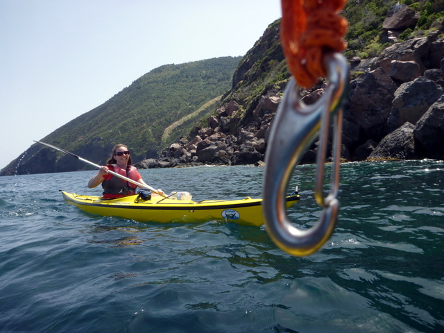 Eugenio taunting me with the tow line.  Photo by Eugenio at Sicily in Kayak